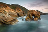 Soberanes Point, in Big Sur near Carmel California is a rugged piece of coastline backed by 4,000 foot mountains. I wanted to isolate this arch and give it a 3D look by doing a long exposure so that the waves do not distract from the rock forms. Also, it was isolated more when I made the top of the arch break the horizon just in one spot. I had to run across a low point in between waves to get out to a rock similar to the arch <br /> in order to get this composition.