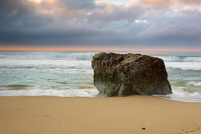 Garrapata beach has many interesting stone formations, like this one right here.  So I waited for the clouds and waves to form a pleasing background with this rock as the main subject.