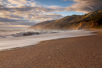 The south end of the Big Sur range feels like one of the most isolated places on Earth. Few people go to this beach, though many pass it by on highway 1 on their way to more accessible destinations.  The sand is like coffee grounds and it crunches when you walk on it.