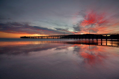 Avila beach at low tide in December really shows off the sky at it's best. No other time of year allows the sun to set so close to the pier. And only low tide shows such complete reflections. This is probably the most sheltered beach in the state of California