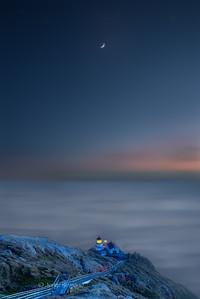 Moon over lighthouse