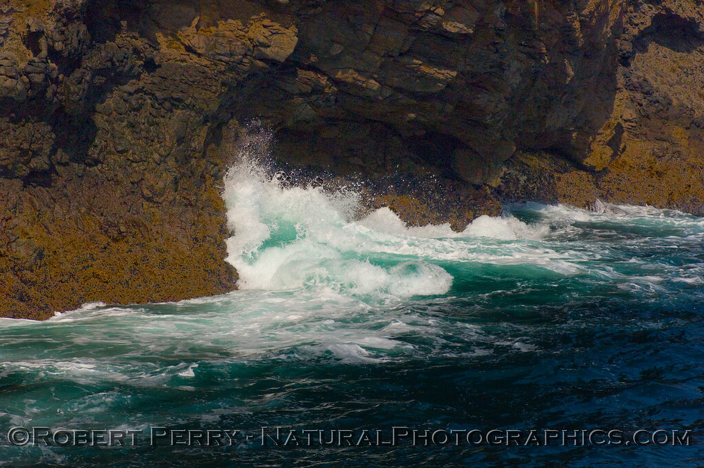 A northwest ground swell sweeps up against the rocky headland near the west end of Santa Cruz Island.