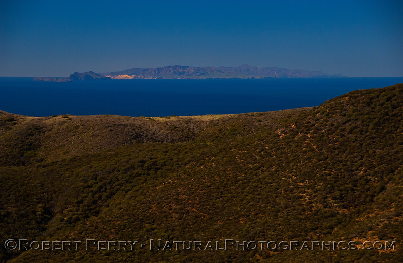 Anacapa & Santa Cruz Island as seen from atop Deer Creek.  Anacapa is to the left and the much larger Santa Cruz is to the right.  The bright spot on the eastern end of Sta Cruz is Yellowbanks Anchorage.  The radar tower on top of Blue Banks can be seen if you enlarge the image by clicking on it.