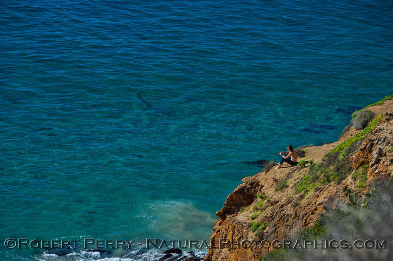 young man sits on ledge over clear water 2012 12-20 Big Dume-014