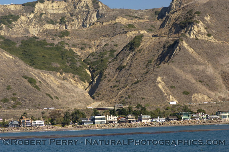 Kelp bed on submerged reef; beachfront homes, and Highway One - Ventura County.