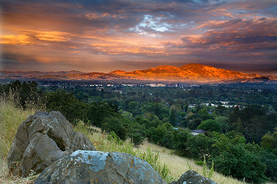 After a small late-season storm rolled though the valley, a hole opened up in the clouds allowing Mt. Diablo to be spotlighted. Pleasant Hill is to the left and Walnut Creek is to the right.  I've lived a few blocks from here for 5 years and this is the best sunset I've seen.  Most of the trees in the valley are planted.  It was dry and barren before people arrived.