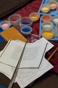 Their tools: brightly colored sand and narrow tapered tubes for dispensing the sand onto the mandala.