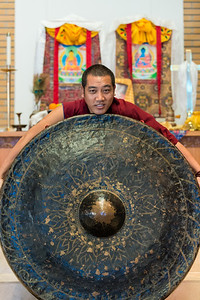 The huge gong (which was made in Indonesia, as I recall), had to be transported back to India with the monks. People donated money to help pay the cost.