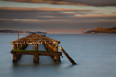 Image #3 of the Berkeley Pier. Here, the light just illuminated the pier; making it stand out as much as the bridge.  The ND 8 filter really helped me get the longest exposure possible to keep the water smooth even in the sunlight.
