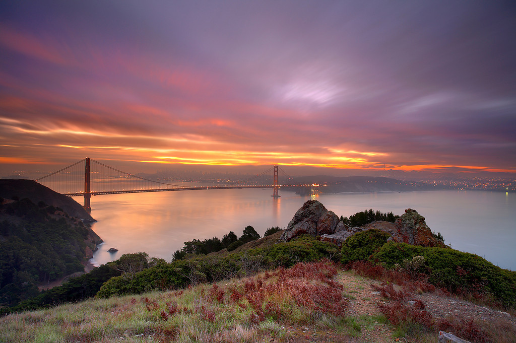 A climb down a crumbly hillside in the dark allowed me to see this view at sunrise. I felt privileged to be here at this time! A long exposure time allowed the clouds to move a considerable distance during the exposure.