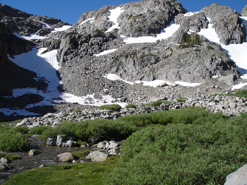 Another view looking S from Sam Mack Meadow. The snowfields on the left and right are popular routes for climbers returning from the Palisade Glacier.<br /> <br /> High Sierra: North Fork Big Pine Creek: Sam Mack Meadows: High Glacier Camp: Palisade Glacier: Palisades: Mount Sill: Swiss Arete