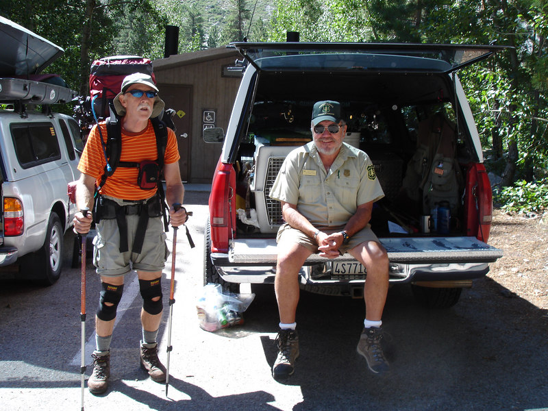 Jim posing next to Mr. Ranger who checked our Wilderness Permit. This is day parking only. We parked our car an .8 mile down the road.<br /> <br /> High Sierra: North Fork Big Pine Creek: Sam Mack Meadows: High Glacier Camp: Palisade Glacier: Palisades: Mount Sill: Swiss Arete