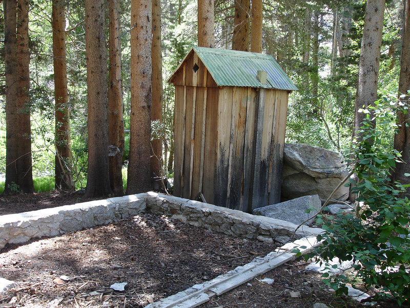 Outhouse and foundation near Lon Chaney cabin.<br /> <br /> High Sierra: North Fork Big Pine Creek: Sam Mack Meadows: High Glacier Camp: Palisade Glacier: Palisades: Mount Sill: Swiss Arete
