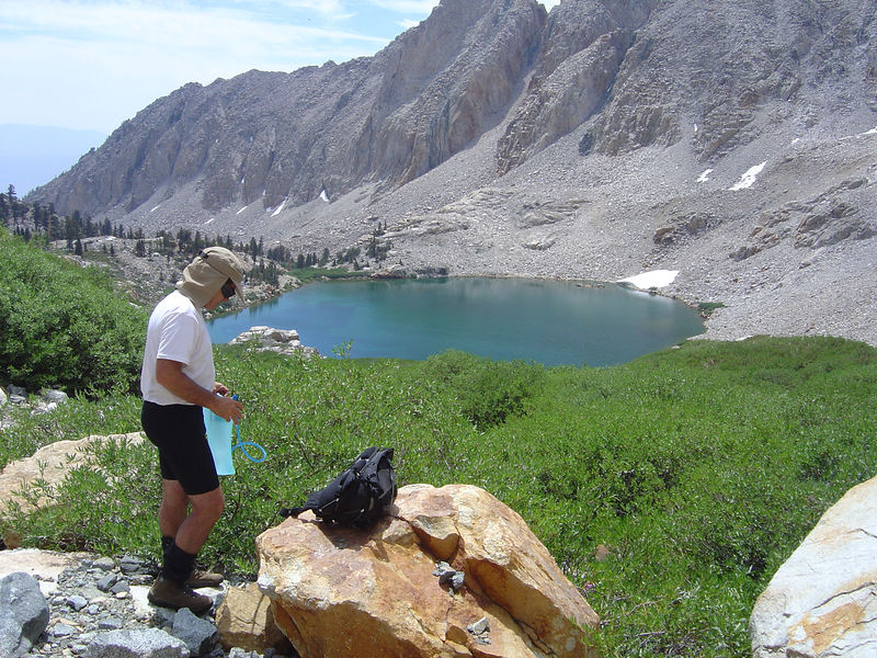 Griff fills his bladder above Red Lake.