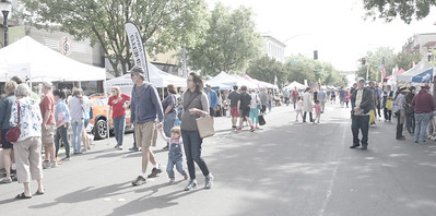 CINTIA LOPEZ - DAILY DEMOCRAT More than 35,000 people attened the California Honey Festival. People walk down Main and stop to buy from a selection of more than 220 vendors.