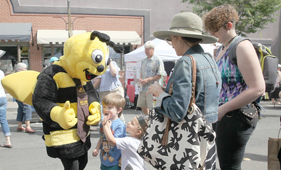 CINTIA LOPEZ - DAILY DEMOCRAT The BZ Bee high fives children before they pose for a photo together at the California Honey Festival in Woodland.
