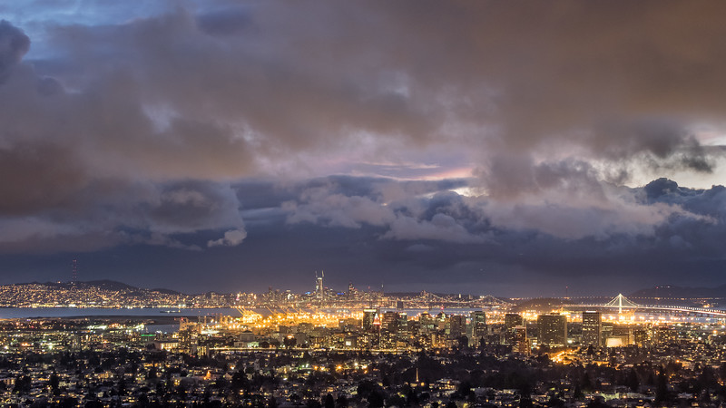 Downtown Oakland and San Francisco and Bay Bridge After Sunset