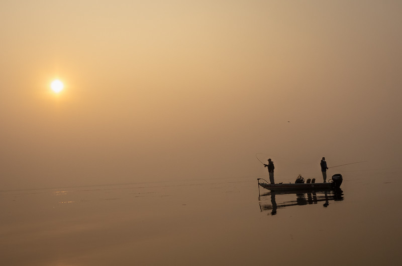 Fly Fishermen and Otherworldly Smoke-Filled Landscape
