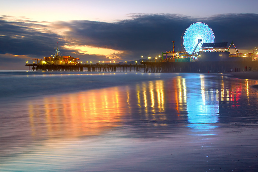 The fourth in the Santa Monica Series shows the new wheel just after sunset.  I waited again for the sand to briefly become smooth and for the ever-changing color of the wheel to be complementary to the blues in the sky.  The wheel does not spin very often so it takes a while to get it right.
