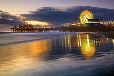 The third in the Santa Monica Series shows the new wheel just before sunset.  I waited for the sand to briefly become smooth and for the ever-changing color of the wheel to be complementary to the warm glow of sunset.  The wheel does not spin very often so it takes a while to get it right.