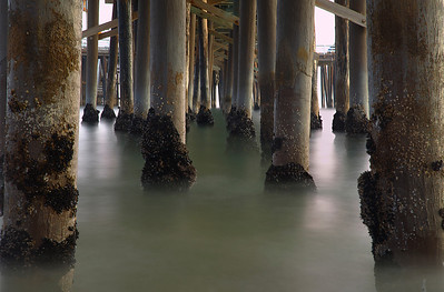 Small waves and low tide allowed lots of detail to be shown during this long exposure.  This was another one where it took a while to move around in order to have as few pillars blocking other pillars as possible and still show detail on the front ones.  And I wanted the front two pillars to frame the image, which complicated matters a bit.