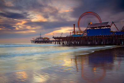 A medium-length exposure shows the spin of the wheel, as riders enjoyed a magnificent sunset over the Santa Monica Pier.  This was the best part of a great sunset, then I waited for the lights on the pier to become as bright as the sky in order to create Santa Monica Spin #2 about 20 minutes later.  For a brief moment in between waves, the sand turned glossy, so I made sure to capture that moment with the wheel in motion, which was not very often during the best part of the sunset!