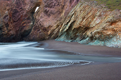 It is a very scenic 40 minute walk from the trailhead in Mill Valley to this beach. Along the way, you can see babcats, owls and lots of other wildlife. The beach and cliffs are multicolored and dramatic. The colors you see here are natural and show up best on a rainy and cloudy day, just as a wet rock has better color than a dry one!