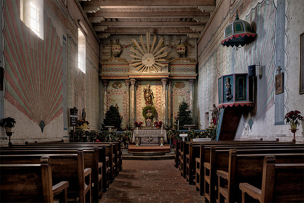 Chapel interior, Mission San Miguel. The paintings on the wall are original from the time the mission was built.
