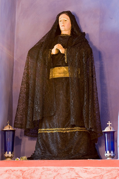 Statue of the virgin Mary, always in mourning, at Mission Soledad.