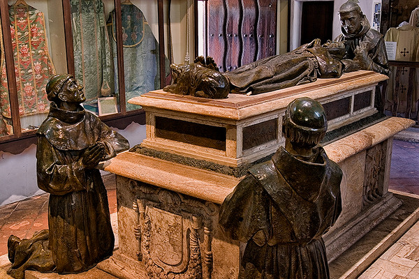 The tomb of Fray Junipero Serra at Mission San Carlos. Here, Father Serra is in repose with Father Crespi at his head, and Father Lasuen and Father Lopez at his feet.