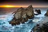Point Lobos, at the north end of Big Sur just south of Carmel, California could keep a photographer busy for months or even years. It is a peninsula that has been sculptured by large Pacific waves over millions of years and the results are stunning. This is one of the western-most points of rock and is probably 50 feet tall at high tide.  Sometimes waves wash over the entire rock.  The most interesting motion was occurring just as the waves curl around the rock.  I painted long lines (but not too long) with a 0.6 second exposure.