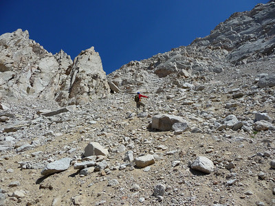 Mike negotiating the almost intolerable scree.  We could see the gap now.