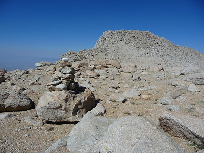 Cairn marking the descent route.