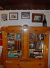 Old photographs above the bookcase.