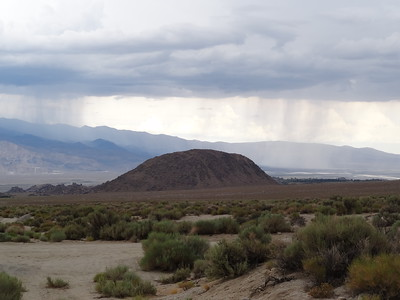 Rattlesnake Peak with storms cells around it.