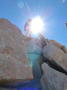 Bob climbing onto the summit plateau.