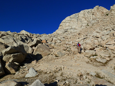 A climber heading up from camp at Upper Boy Scout Lake.