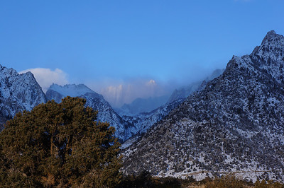 Thor Peak, the Needles and Mt. Whitney peeking thru the clouds.