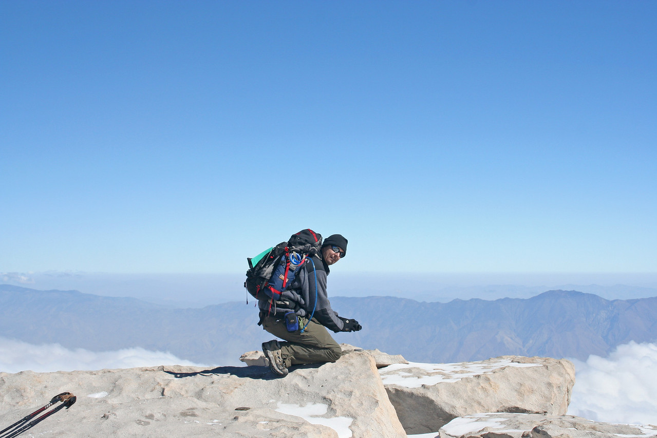 Chris on the summit of Mt. Whitney.<br /> <br /> I could say he was saying a prayer of thanks, but...