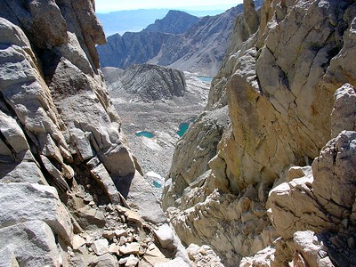 """Looking through one of the """"windows."""" Lone Pine Peak and Consultation Lake can be seen in the distance."""