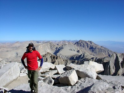 Richard Piotrowski on the summit of Mt. Whitney. Mt. Russell and Mt. Williamson can be seen in the background.