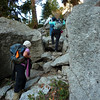 Ava, Bee and Doug Sr. climbing thru Split Rock.