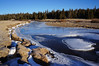 Tuolumne River.<br /> <br /> As the sun starting hitting the river ice, it started talking.