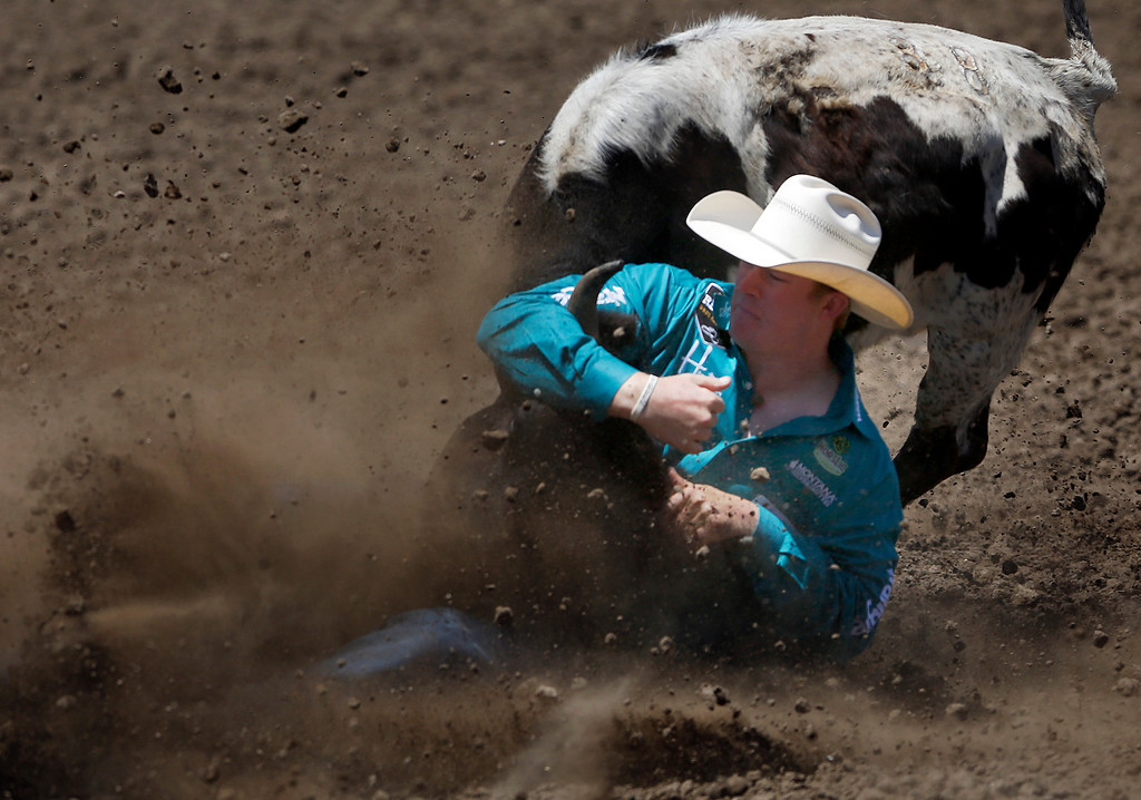 . Steer wrestler Ty Erickson of Helena, MT competes during the California Rodeo Salinas at the rodeo grounds in Salinas on Thursday July 20, 2017. (David Royal/Herald Correspondent)