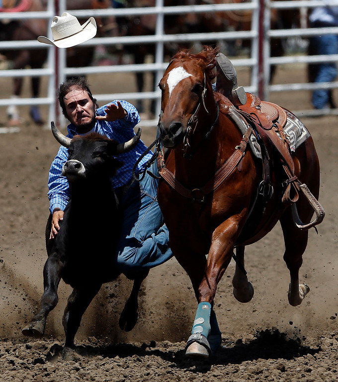. Miguel Garcia of Kaycee, Wy competes in the steer wrestling event during the California Rodeo Salinas at the rodeo grounds in Salinas on Thursday July 20, 2017. (David Royal/Herald Correspondent)