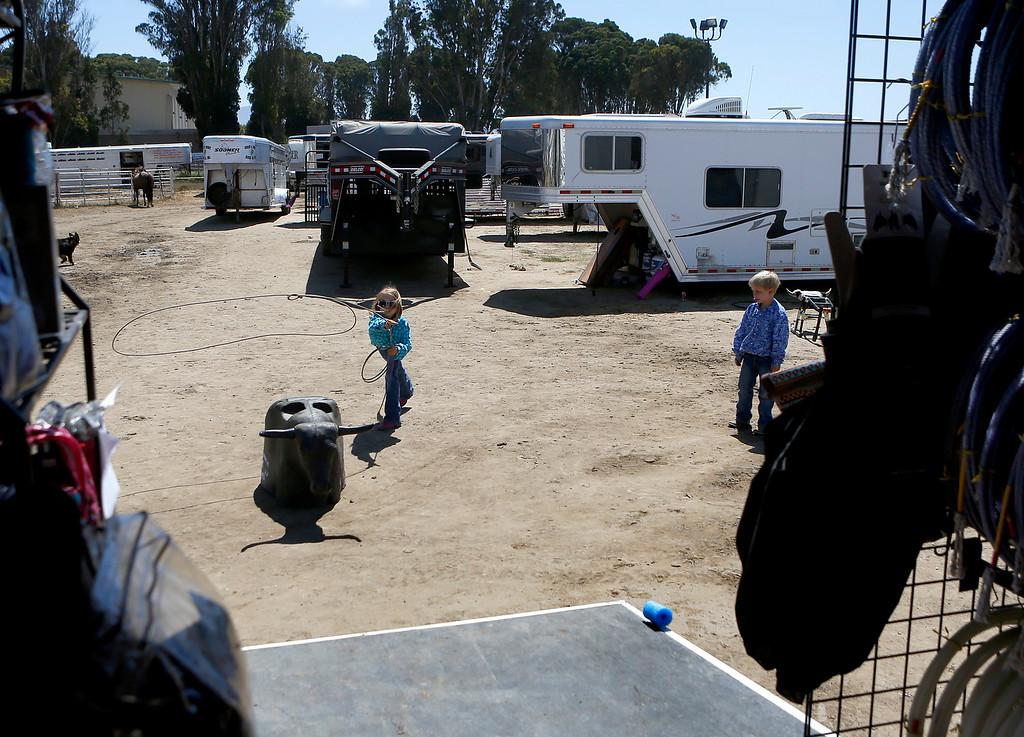 . Maci Cohn, 8, and her brother Max, 6, take turns roping a roping dummy outside the Steer Gear trailer during the California Rodeo Salinas at the rodeo grounds in Salinas on Thursday July 20, 2017. (David Royal/Herald Correspondent)