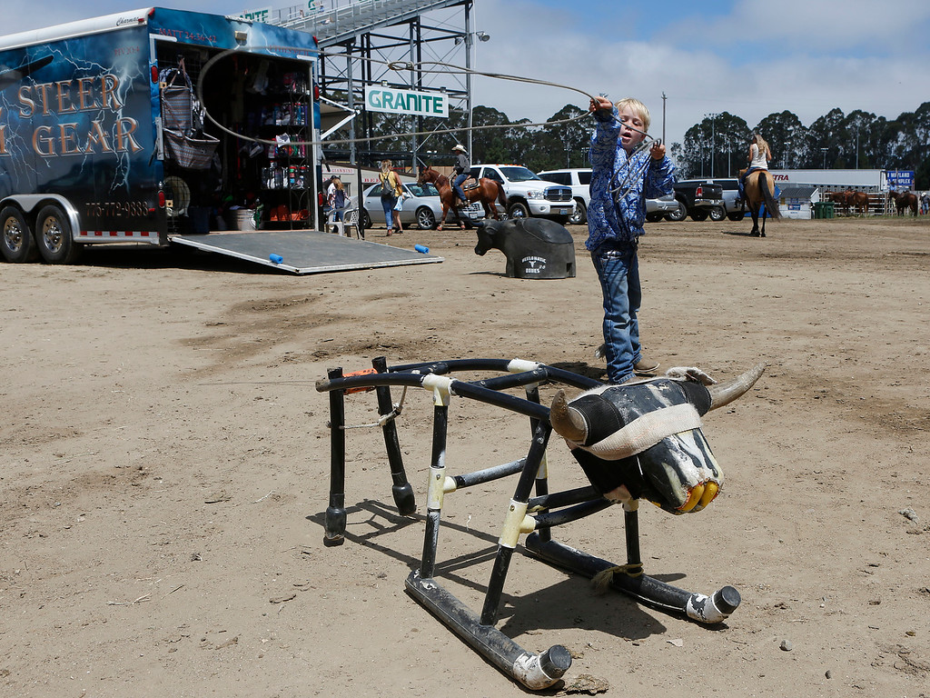 . Max Cohn, 6, ropes a roping dummy outside the Steer Gear trailer during the California Rodeo Salinas at the rodeo grounds in Salinas on Thursday July 20, 2017. Max\'s father Ed Cohn is a pro roper. (David Royal/Herald Correspondent)