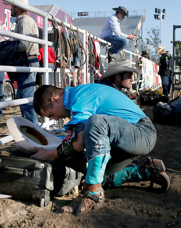 . Mike Lee prays prior to competing in the Professional Bull Riding event at the Salinas Rodeo grounds on Wednesday July 19, 2017. (David Royal/Herald Correspondent)