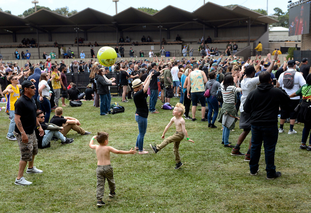 . Charlie Seal plays soccer with sons Avery, 4, and Briley, 8, as RDGLDGRN perform at the California Roots Music and Art Festival at the Monterey County Fair and Events Center on Sunday May 28, 2017.  (David Royal - Monterey Herald)