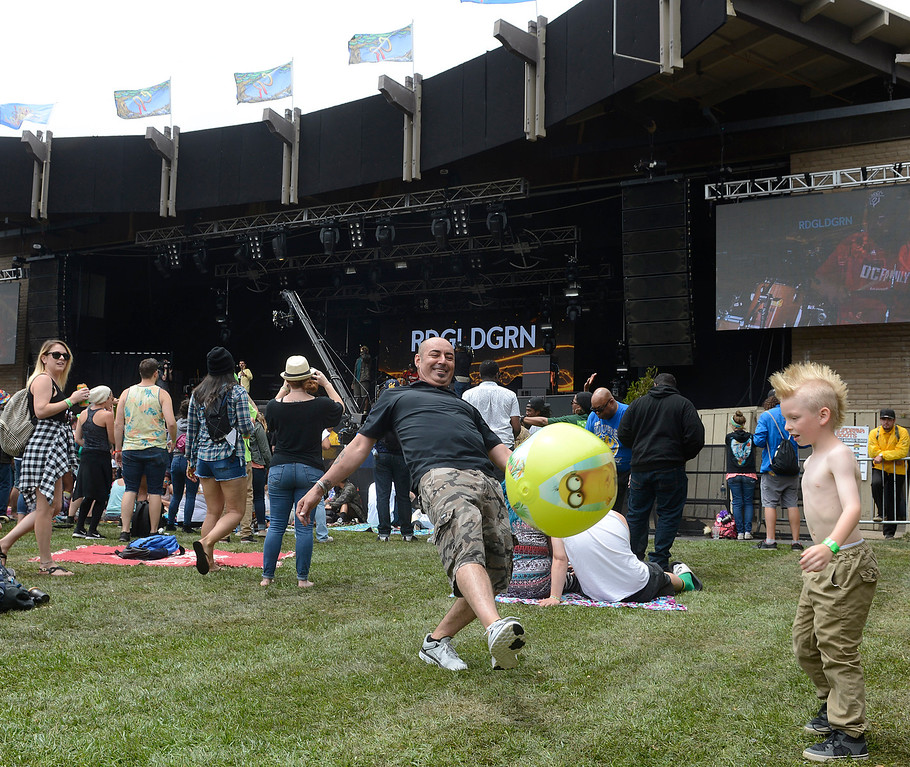 . Charlie Seal plays soccer with his son Briley, 8, as RDGLDGRN perform at the California Roots Music and Art Festival at the Monterey County Fair and Events Center on Sunday May 28, 2017.  (David Royal - Monterey Herald)